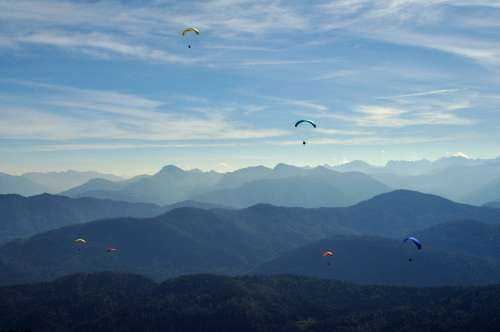 Paragliders over the Alps