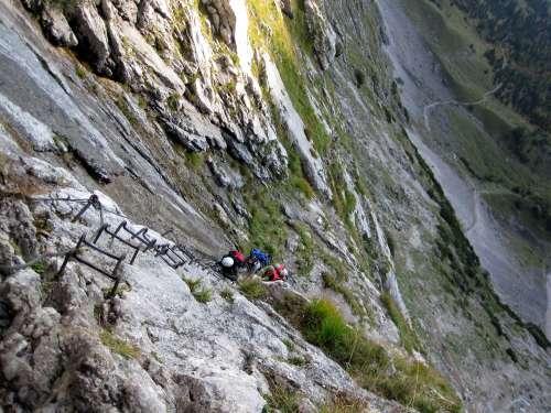 Climbing a ladder below the glacier