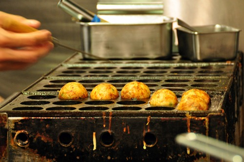 Cooking takoyaki at Jinroku Pacific in Waikiki