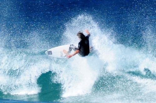 Surfer trick at Bondi Beach